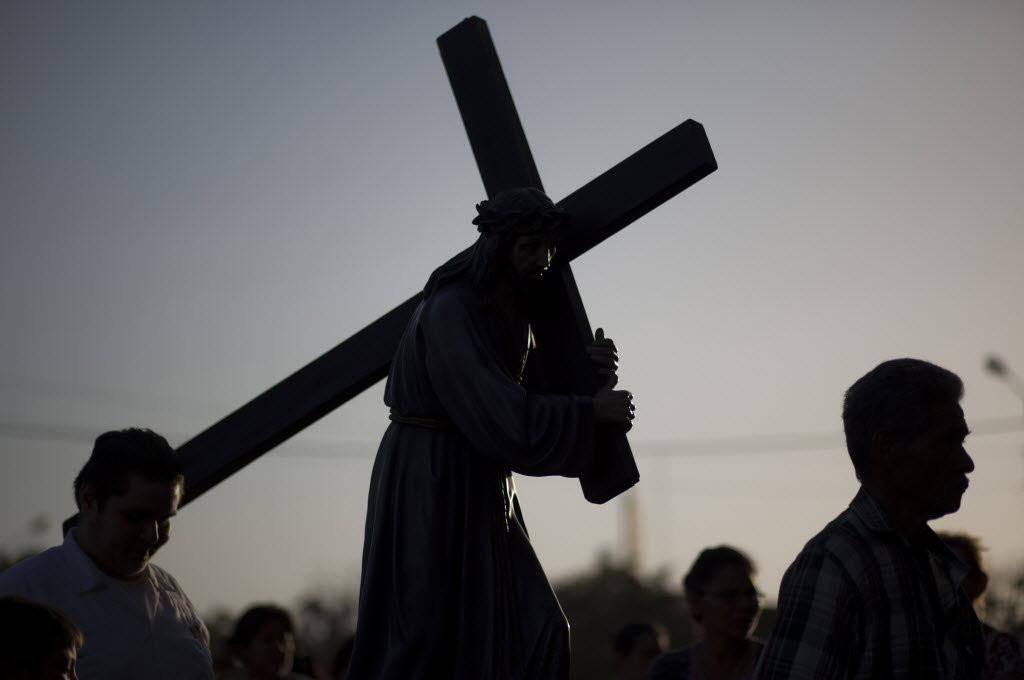 figure carrying cross