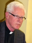Fr Ross looks serious